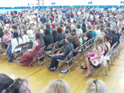 Timothy seated for North Middle School Graduation